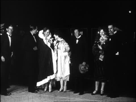 B/W 1920s slow motion directors producers stars entering Graumann's Chinese Theater for movie premiere