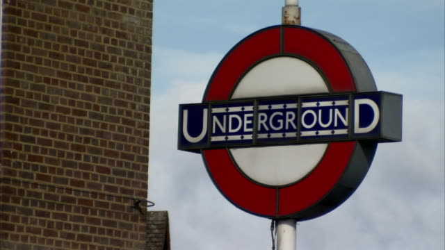 A 1920s style London Underground sign outside Rayners Lane station, London. Available in HD.