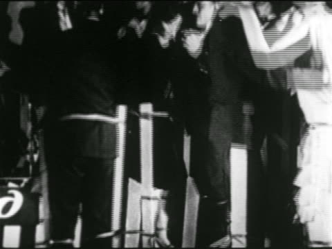 b/w 1920s tilt down couples dancing on stilts in nyc nightclub / newsreel - stilts stock videos and b-roll footage