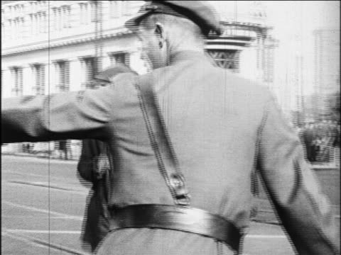 b/w 1920s traffic cop directing black man crossing street / oakland, california / newsreel - african american ethnicity stock videos & royalty-free footage