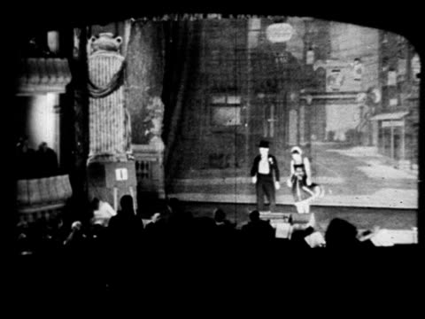 vaudeville flyer page from palace theatre w/ dates performers acts ws male female walking onto stage ms both standing in front of orchestra pit at... - tap dancing stock videos & royalty-free footage