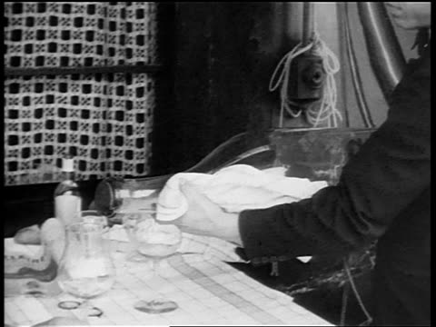 b/w 1920s waiter pouring from giant bottle of wine at table in outdoor cafe / paris / documentary - french restaurant stock videos & royalty-free footage