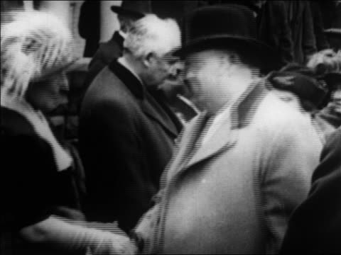 1920s warren g. harding + others standing in line shaking hands with group passing / newsreel - 50 59 years stock videos & royalty-free footage