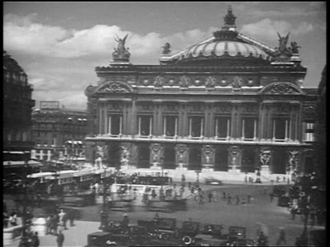 b/w 1920s wide shot time lapse crowd + traffic in front of opera de paris / paris / documentary - place de l'opera stock videos and b-roll footage