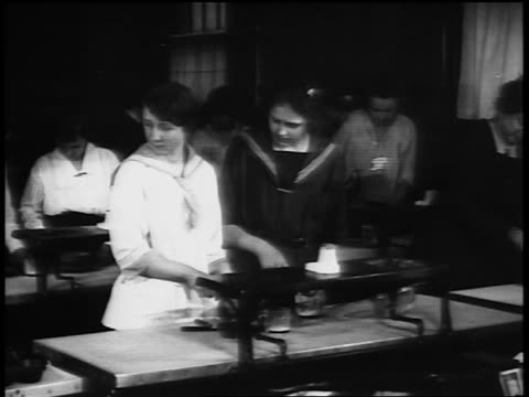 b/w 1920s women working at lab table in vocational school / newsreel - laboratory stock videos & royalty-free footage