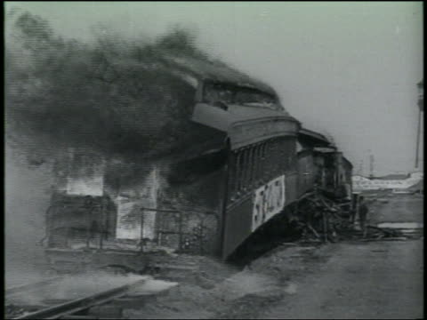 B/W 1920s/30s passenger cars of train burning after accident / Los Angeles