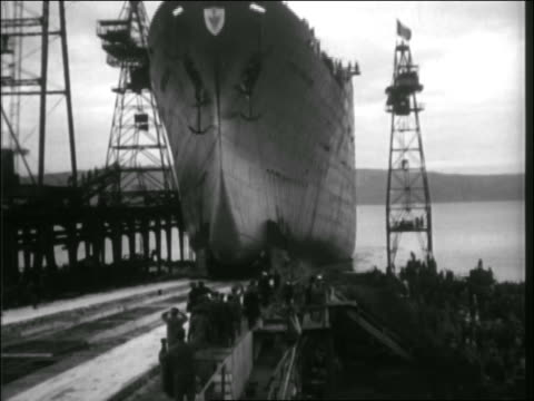 b/w 1920s/30s ship being launched into water / crowd on dock cheers - passenger craft stock videos & royalty-free footage