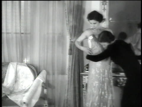 1930s ms a dressmaker fitting a woman's dress  - dress stock videos and b-roll footage