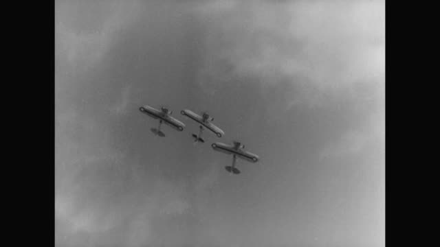 1930s a military flight performance takes place - 1930 1939 stock-videos und b-roll-filmmaterial