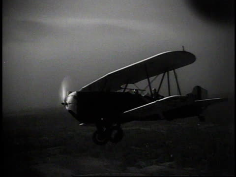 1930s aerial a biplane flying / new york, new york, united states - 1930 stock videos and b-roll footage