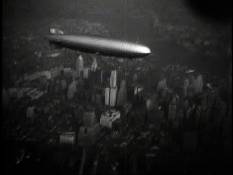 1930s aerial hindenburg flying / new york new york united states - airship stock videos & royalty-free footage