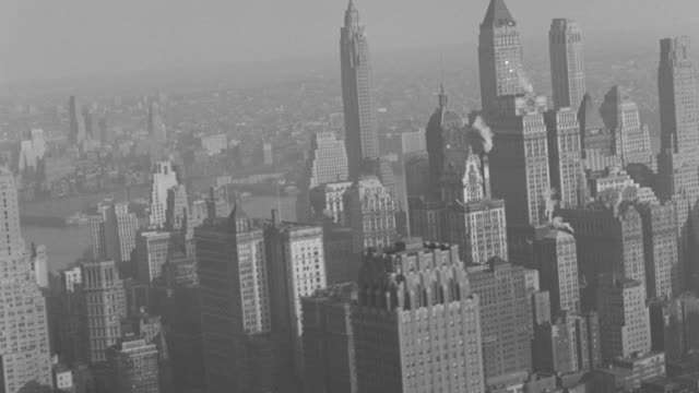 stockvideo's en b-roll-footage met ws 1930s aerial view of manhattan with east river and queens,  brooklyn - 1930