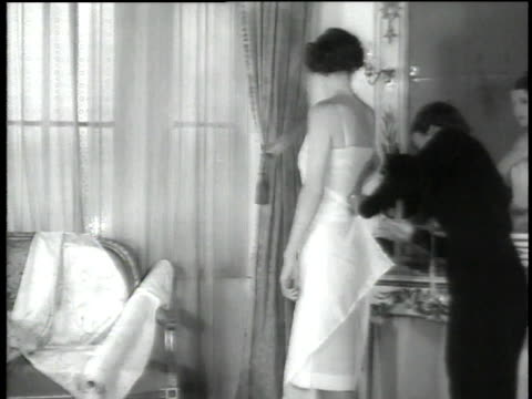 1930s anna de wolkoff fits a dress on a model - dress stock videos and b-roll footage