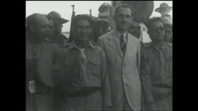 BATISTA IN CONTROL HD Colonel Fulgencio Batista standing w/ Dr Ramon Grau San Martin other unidentified soldiers MS Fulgencio Batista smiling 1940s...