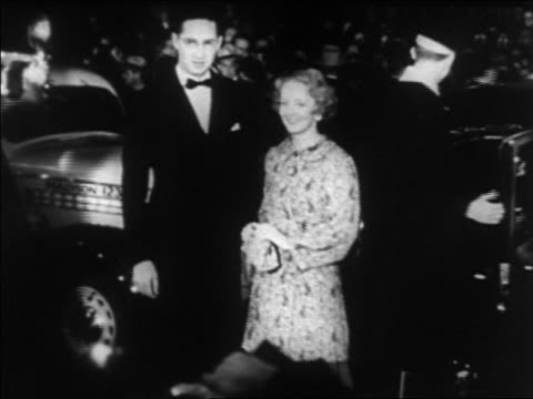 B/W 1930s Bette Davis husband posing at Hollywood premiere at Grauman's Chinese Theater / newsreel