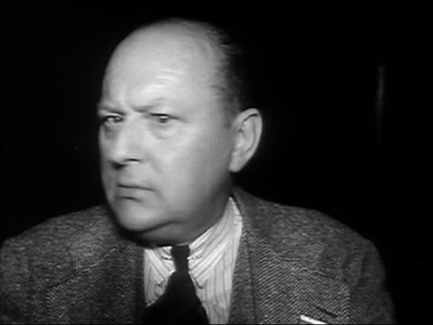 1930s black and white close up cross-eyed, bald man with double chin, shaking head back and forth / looking at CAM