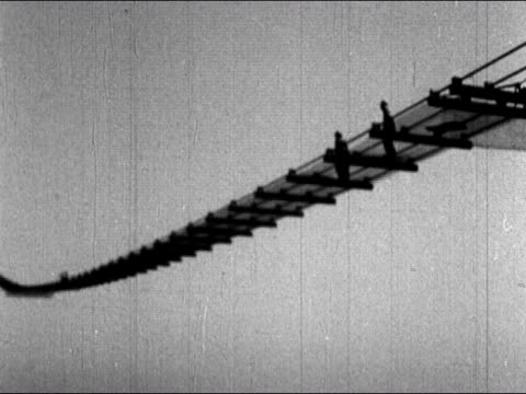 1930s black and white low angle long shot construction workers jump up and down on mesh catwalk / san francisco bay / audio - jump shot stock videos and b-roll footage