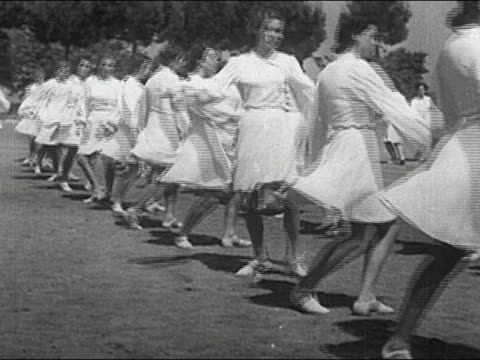 1930s black and white wide shot women dancing in choreographed routine on lawn / italy - human limb stock videos & royalty-free footage