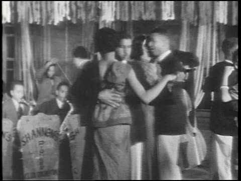 vídeos de stock e filmes b-roll de b/w 1930s pan black couples dancing in nightclub / alabama / documentary - 1930
