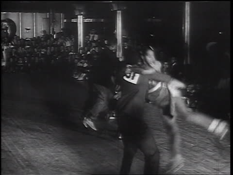 vidéos et rushes de b/w 1930s black couples swing dancing with acrobatics near seated spectators - rock