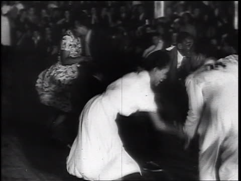 vidéos et rushes de b/w 1930s black couples with numbers on backs swing dancing near seated spectators - rock