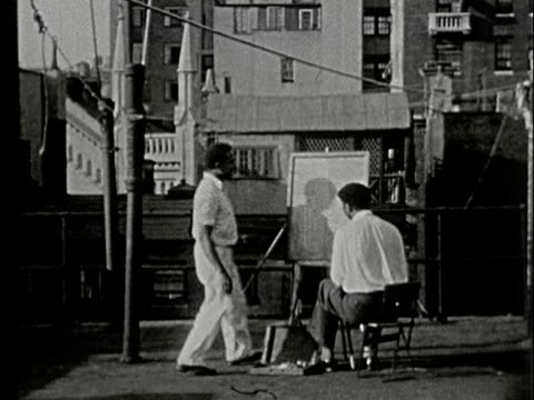 1930s b/w ms, cu, composite, artist painting on easel on rooftop, new york, city, new york state, usa - artist stock videos & royalty-free footage