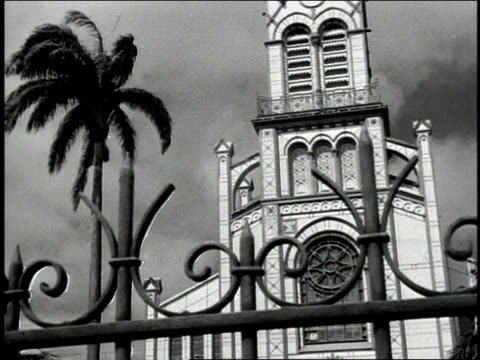 1930s b/w gardeners working outside a church - church stock videos & royalty-free footage
