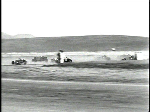 1930s b/w hot rod cars racing around track / corona show grounds speedway, corona, california, united states - corona zentralkalifornien stock-videos und b-roll-filmmaterial