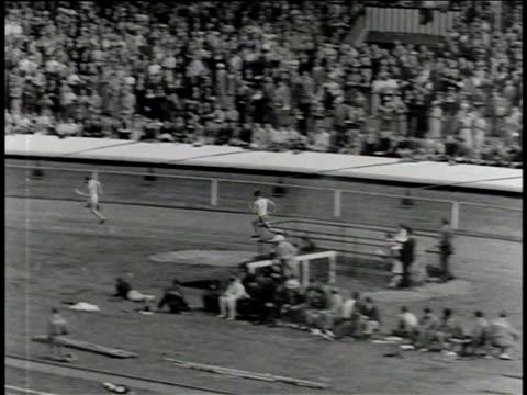 1930s B/W Jesse Owens competing in British Empire Commonwealth Games / United Kingdom
