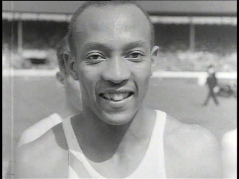 1930s B/W Jesse Owens smiling at the British Empire Commonwealth Games / United Kingdom