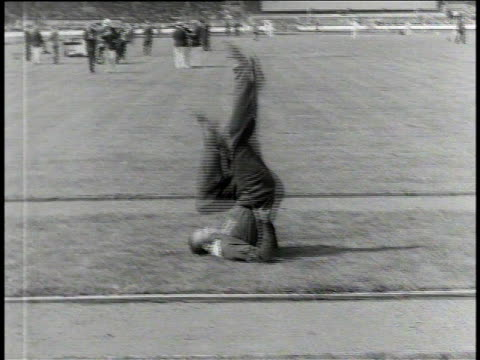 1930s B/W Jesse Owens stretching and preparing for races at the British Empire Commonwealth Games / United Kingdom