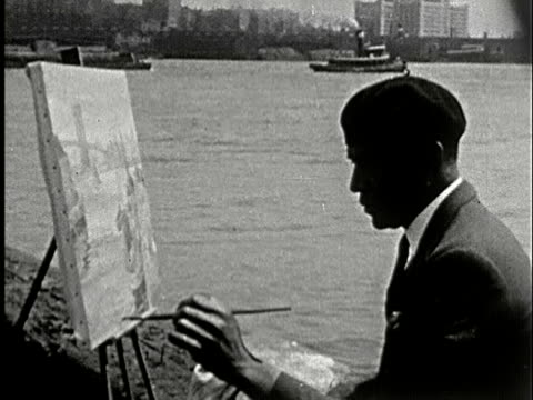 1930s b/w ms, man painting on easel sitting on river bank, new york city, new york state, usa - artist stock videos & royalty-free footage