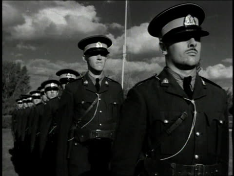 1930s B/W Military troops saluting and standing at attention