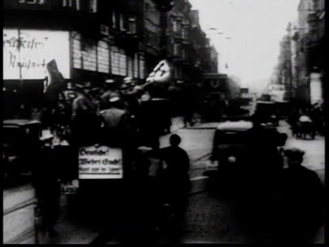 1930s b/w nazi brown shirts riding in motorcade / germany - human limb stock videos & royalty-free footage