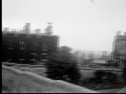 1930s b/w ms pan castle and surrounding buildings on rainy day - vintage car stock videos and b-roll footage