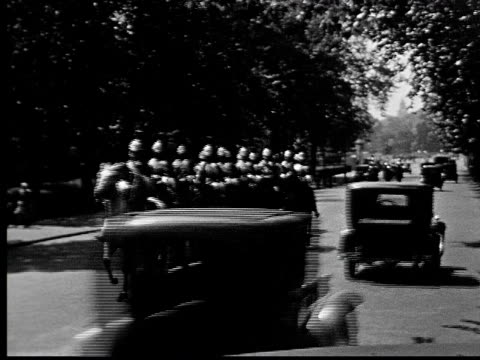 1930s b/w ws pan guards on horseback ride up road as traffic moves by - sidecar stock videos & royalty-free footage