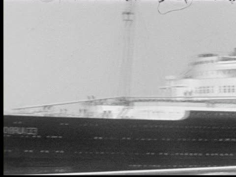 1930s b/w ws pan view of cruise liner europa from deck of other ship - 1935 stock-videos und b-roll-filmmaterial