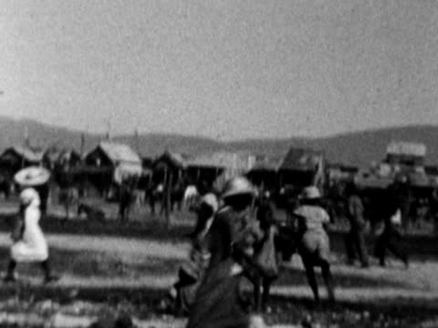 1930s b/w ws pan people in village / haiti - west indies stock videos & royalty-free footage