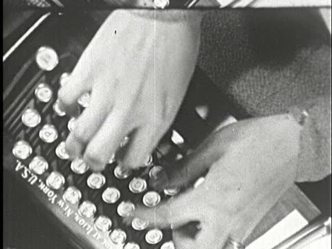 1930s b/w cu, ha, person rapidly typing on typewriter, new york city, new york state, usa - タイプライター点の映像素材/bロール