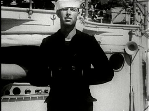 1930s b/w ms, portrait of sailor adjusting jacket standing on ship deck - sailor stock videos & royalty-free footage