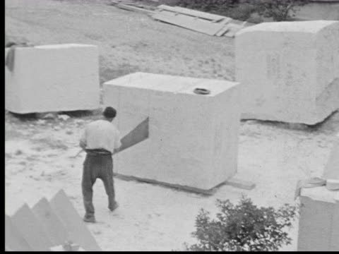 1930s b/w ha ws stone cutter sawing large rock - stone material stock videos & royalty-free footage