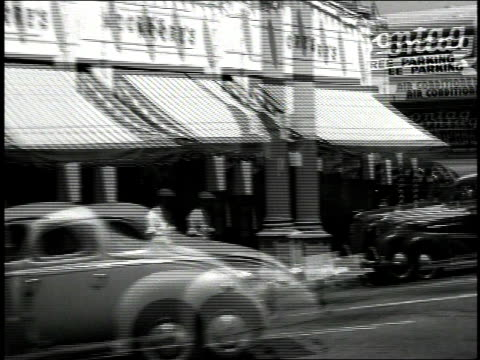 1930s b/w town streets from a moving car / united states - urban road stock videos & royalty-free footage