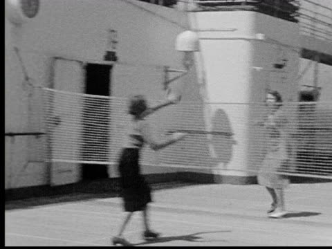 1930s B/W MS two women playing game on deck of ship