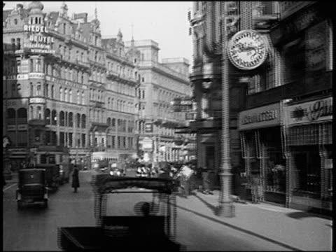 b/w 1930s car point of view in traffic on busy city street / vienna, austria - vienna austria video stock e b–roll