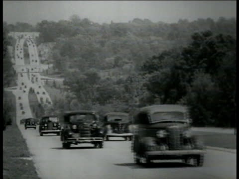 ws 1930s cars on four lane highway road branching off to right light traffic ws cars on uphill highway w/ long road bg ws highway overpasses vs... - autostrada interstatale americana video stock e b–roll