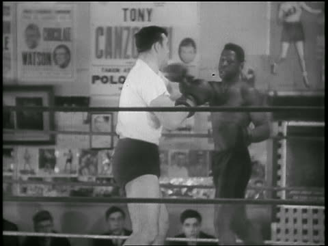 b/w 1930s caucasian boxer boxing with black boxer in practice in gym - primo carnera stock videos and b-roll footage