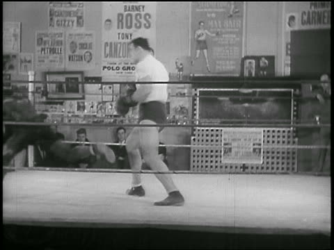 b/w 1930s caucasian boxer knocking down black boxer in practice in gym - primo carnera stock videos and b-roll footage