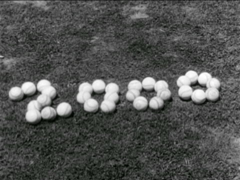 b/w 1930s close up 2000 spelled out in baseballs in grass - cinematografi bildbanksvideor och videomaterial från bakom kulisserna
