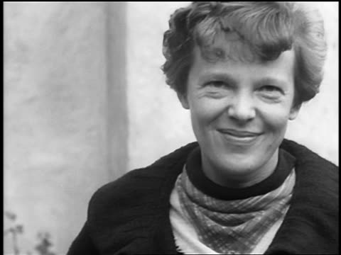 B/W 1930s close up Amelia Earhart smiling outdoors / newsreel