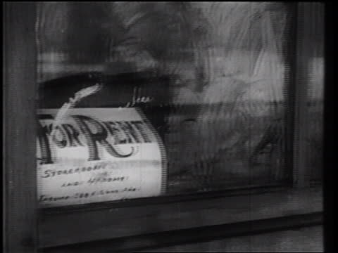"""B/W 1930s close up PAN """"For Rent"""" sign in window to deserted street of town in Winter / industrial"""